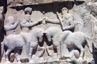 Ahura Mazda (right, with high crown) presents Ardashir I (left) with the ring of kingship. (Naqsh-e Rustam, 3rd century CE)